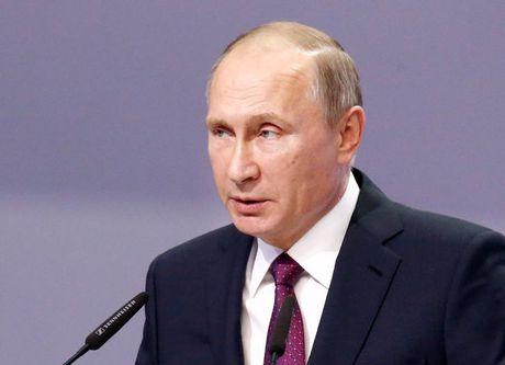 Putin len tieng ve cuoc gap voi Tong thong dac cu Donald Trump - Anh 1
