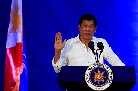 Bat chap luat quoc te, Duterte ung ho phat tu tre tu 9 tuoi - Anh 1