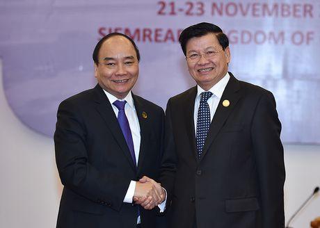 Thu tuong Nguyen Xuan Phuc hoi kien Thu tuong Lao - Anh 1