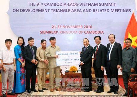 Thu tuong Nguyen Xuan Phuc hoi kien Thu tuong Lao - Anh 2
