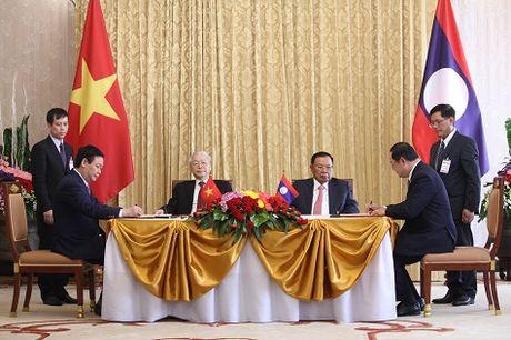 Viet Nam, Lao ky ket 7 van kien hop tac - Anh 1