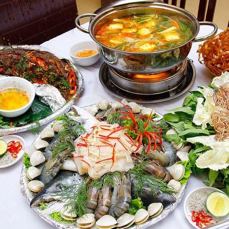 Ngay lanh, an lau hai san the nao cho an toan? - Anh 1