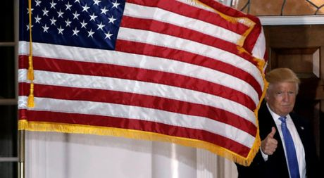 Trung Quoc doa dung WTO de chong ong Donald Trump - Anh 1