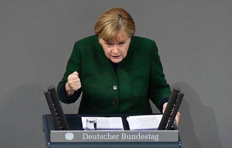 Angela Merkel 'nhan tran' khi Donald Trump tuyen bo rut khoi TPP - Anh 1