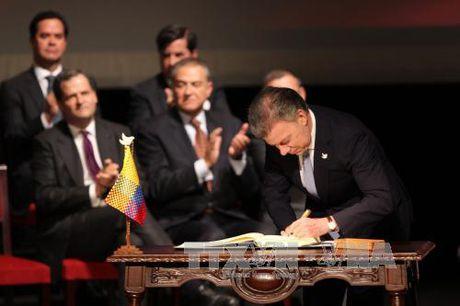 Chinh phu Colombia va FARC ky thoa thuan hoa binh sua doi - Anh 1