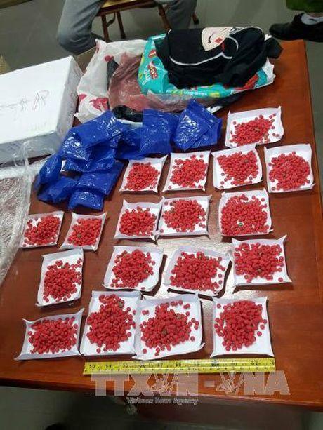 Quang Ninh bat giu doi tuong van chuyen 1 kg ma tuy - Anh 1