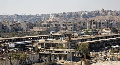 Nga: Quan doi Syria giai phong 40% dong Aleppo khoi khung bo - Anh 1