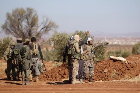 IS tan cong hoa hoc, 22 phien quan Syria bi thuong - Anh 1