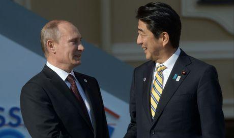 Vi sao Thu tuong Nhat phai dau dau voi bo ba Trump- Putin- Kim Jong-un? - Anh 1