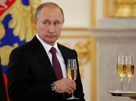 Donald Trump tro thanh TT My, ong Putin chua chac se gap loi - Anh 1
