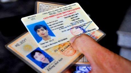 Doi Giay phep lai xe: Bo Tu phap 'tuyt coi', Bo GTVT sua Thong tu - Anh 1