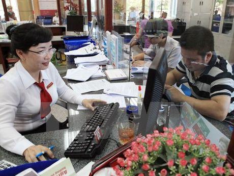Tang truong tin dung tang 14,57% so voi cuoi nam 2015 - Anh 1