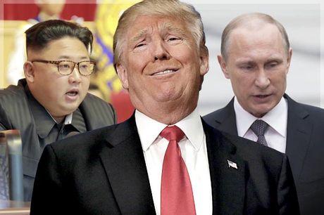 Putin, Kim Jong-un hay IS se giup Donald Trump chung minh thuc luc? - Anh 1