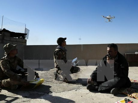 Gan 100 phien quan IS bi tieu diet tai Mosul trong ngay 25/12 - Anh 1