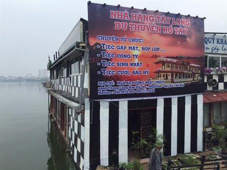 Di doi nha noi Ho Tay: Xu ly vi pham nen khong co boi thuong - Anh 1