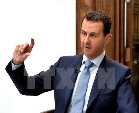 Tong thong al-Assad: My tiep tuc muon lat do chinh quyen Syria - Anh 1