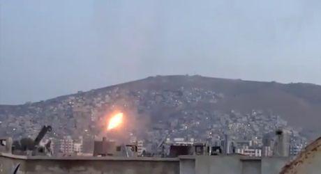 Quan doi Syria danh pha ac liet phien quan ngoai vi Damascus - Anh 1