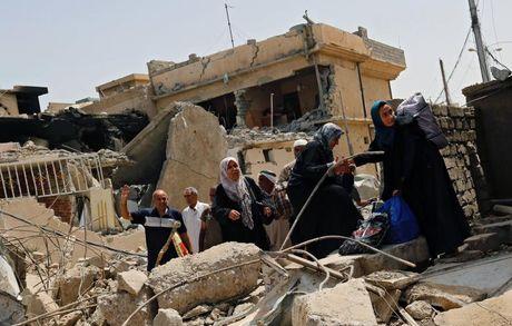 Chum anh giai phong Mosul: Phien quan IS 'ca nam tren thot' - Anh 10