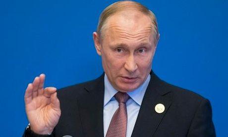Ong Putin: Tong thong Donald Trump khong tiet lo bi mat gi voi Nga - Anh 1