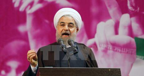Bau cu tong thong Iran: Tong thong Rouhani dang dan dau - Anh 1
