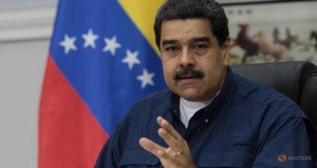 Ong Trump bi canh bao 'dung nhung tay' vao Venezuela - Anh 1
