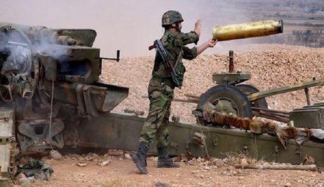 Quan doi Syria diet 11 xe tang IS, giai phong thanh pho Rasaf - Anh 1