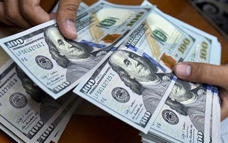 Ngan hang Nha nuoc nang gia mua USD lan thu 3 trong nam nay - Anh 1