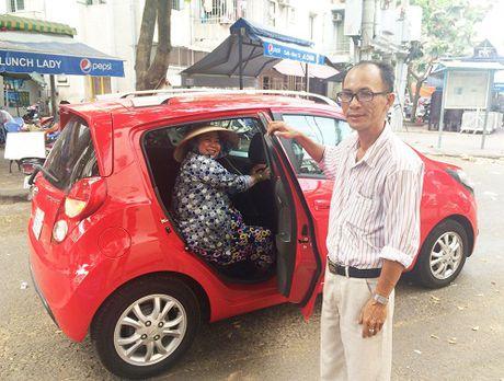 Grab, Uber chiu muc thue khac taxi truyen thong nhu the nao? - Anh 1