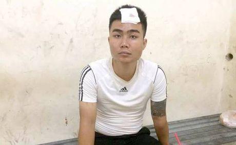 Tam giu hinh su doi tuong hung han dung gay golf tan cong CSGT Ha Noi - Anh 1