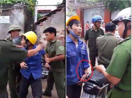 Thuc hu clip cong an xa dung cong so 8 bat giu nguoi trai phep o Ha Noi - Anh 1