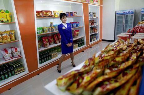 Bi cam van, Trieu Tien tang cuong san xuat hang hoa noi dia - Anh 1
