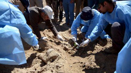 Iraq tim thay 2.100 thi the dan thuong sau giai phong Mosul - Anh 1