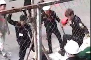 Hơn chục bảo vệ đánh gục 2 công nhân ở Sài Gòn
