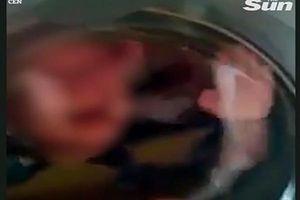 Kinh hoàng clip bé trai bị nhốt trong máy giặt đóng kín cửa