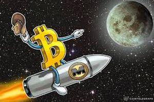 Bitcoin bất ngờ tăng lên trên 7.000 USD