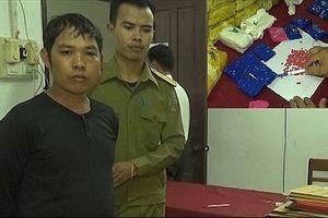 Đối tượng người Lào vận chuyển hơn 100.000 viên ma túy và súng về Việt Nam